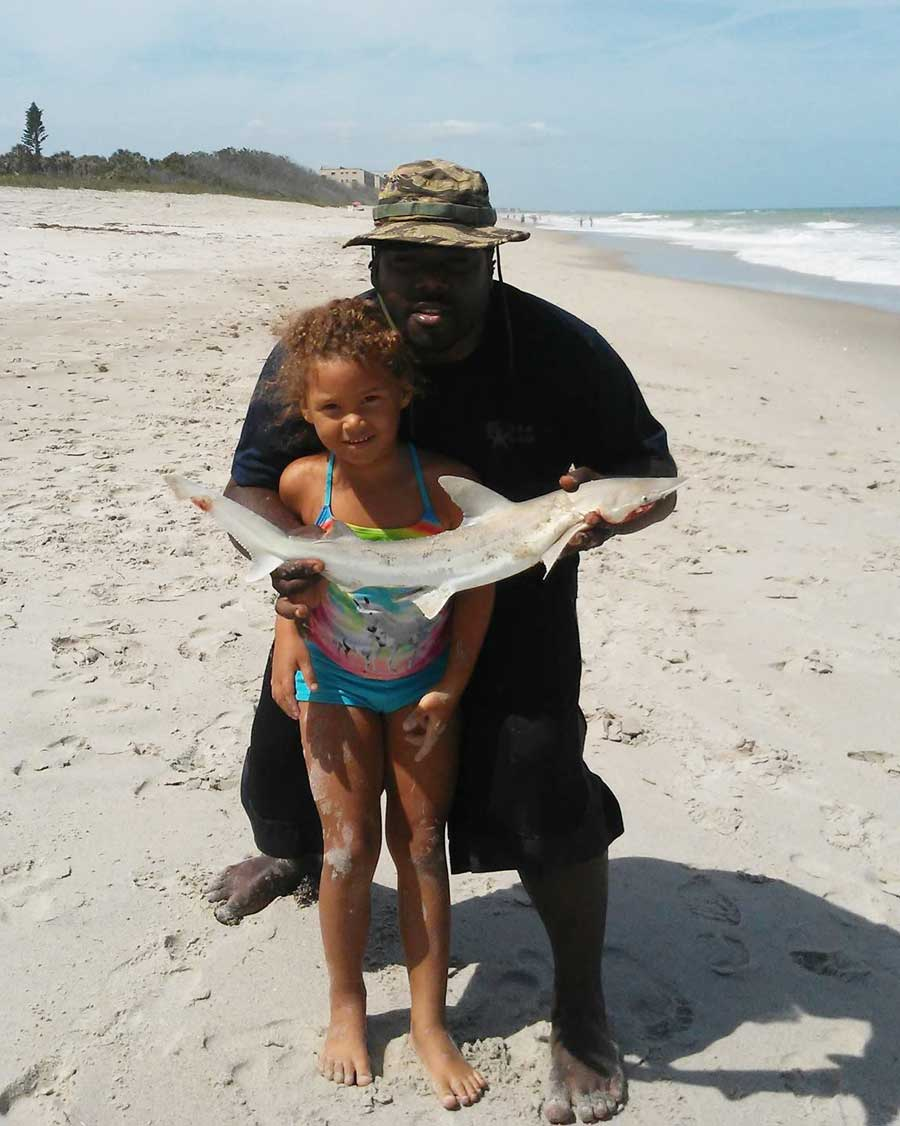 BD catches a shark surf fishing in Satellite Beach with his daught
