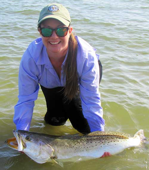 This girl knows how to catch the big trout!