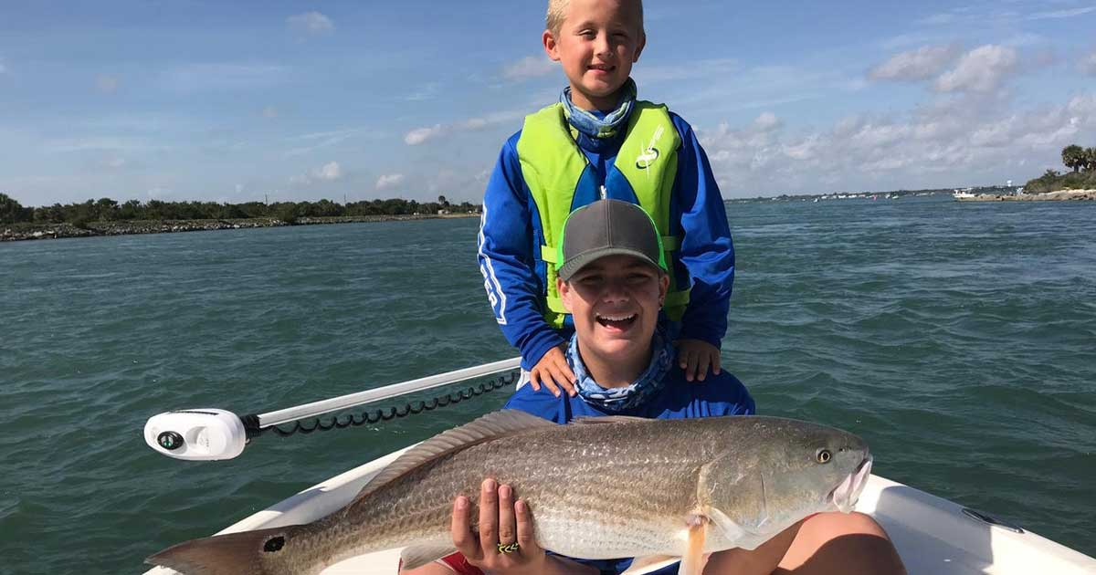 Happy kids with big Sebastian Redfish